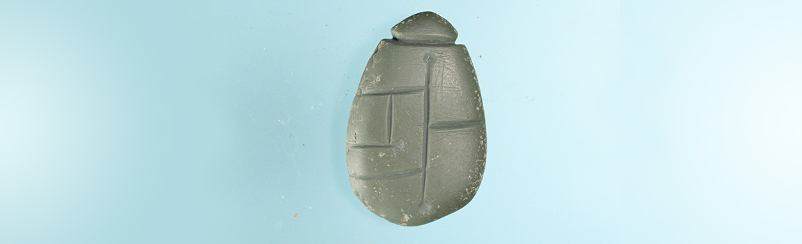 Carved novaculite pendant from Chicot County, Arkansas
