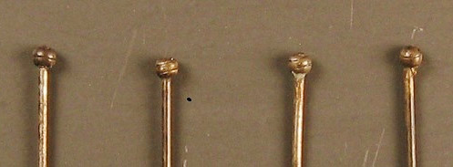 Figure 5. Close-up of straight pin heads showing brass wire wrapped around the shaft.