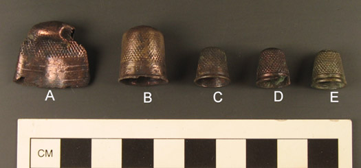 Figure 6. Thimbles from Feature 1 at Davidsonville (thimble e, at the far right, was found in the leather pouch).