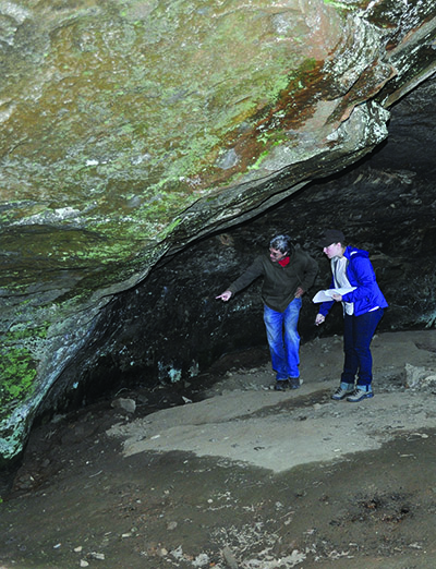 Jerry Hilliard at The Narrows rock art site with Environmental Dynamics Program Ph.D. student Kaelin Groom