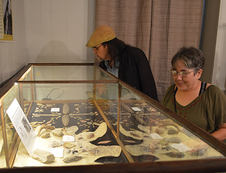 Tunican Chapter members, Cheri and Russ Miller, looking at the flintknapping display, reorganized with help from Jodi Barnes (ARAS-UAM), at the Drew County Historical Museum. ARAS-UAM photo DSC_0096.