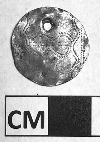 Silver pendant found at the Drennen-Scott Historic Site.
