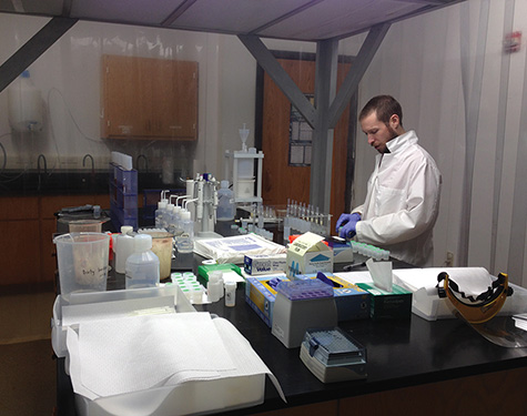 Graduate student and NSF grant recipient John Samuelsen analyzing data in the isotope lab on the University of Arkansas-Fayetteville campus.