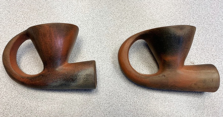Painted finish applied to two replica pipes.