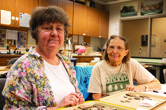 State Archeologist Ann Early with volunteer Pat Corbin in the ARAS lab in 2019. Photo by Rachel Tebbetts.