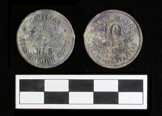 Front and reverse sides of the exchange token found at Camp Halsey in the chimney base of Building 6, Officer's Quarters.