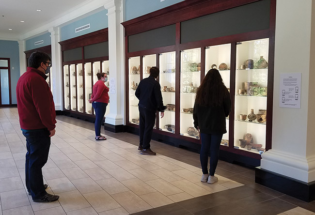 Visitors view items from the JEC Hodges collection on open storage exhibit at the Caddo Center on the HSU campus.