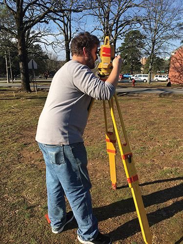 Robert Scott (ARAS-UAPB) uses the total station to map an area where unmarked graves are suspected at Arkansas School for the Deaf in Little Rock.