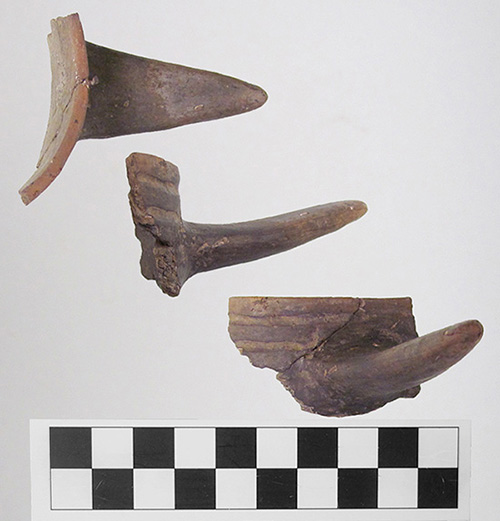 Three views of the beaker handle fragment