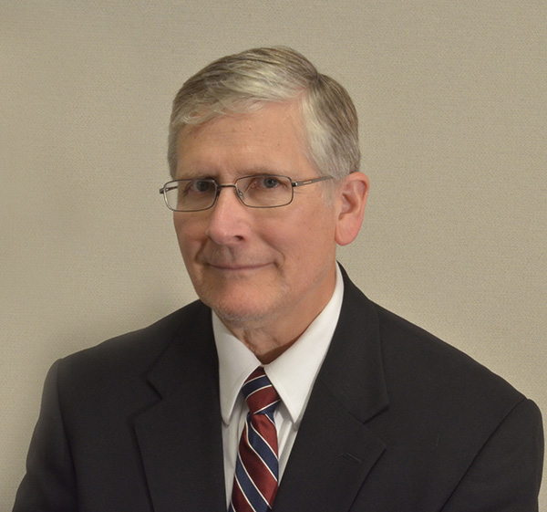 Formal photo of Dr. George Sabo III